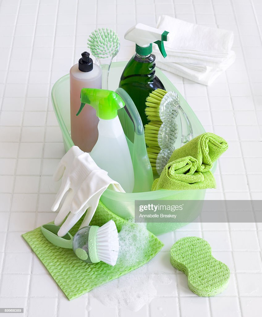Soap suds with green cleaning supplies : Stock Photo