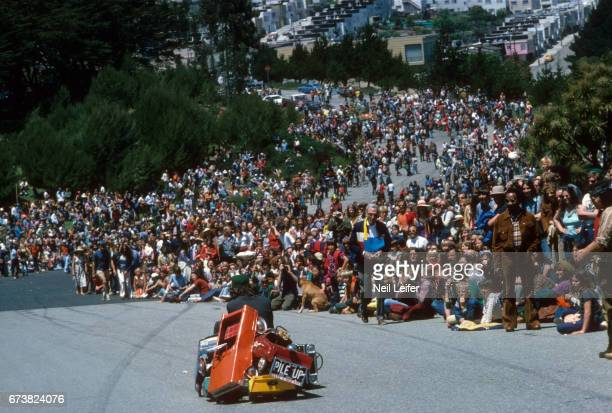 1st SFMMA Artists' Soap Box Derby View of racer in custommade scrap metal car during event at McLaren Park The event was organized by the San...