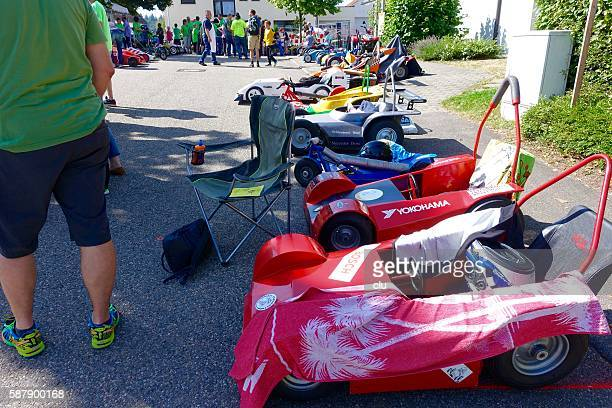 Soapbox racing cars parked at the street waiting for start