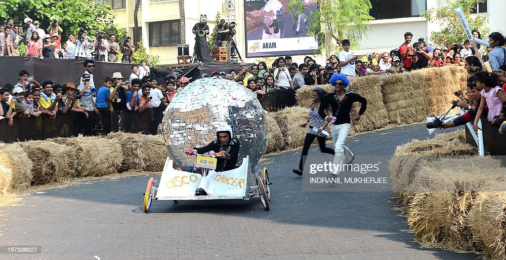 A soapbox team negotiates a curve during India's first Soapbox race in Mumbai on December 2, 2012. Soapbox racing is popular in western countries- is a non-motorised racing event where the task is to design and build imaginative, human-powered soapbox machines and compete against the clock on a downhill race course featuring jumps, bumps and curves. A total of 4 team members, including 1 driver and 3 co-drivers steer each soapbox which must be powered by gravity and imagination.