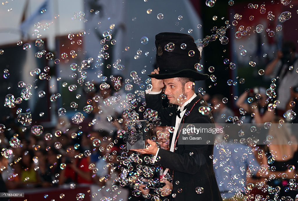 Soap-bubble magician Michele Cafaggi a guest of Jaeger-LeCoultre creates soap bubbles on the red carpet for the 'Emergency' charity at the 'Tracks' premiere during the 70th Venice Film Festival at the Palazzo del Cinema on August 29, 2013 in Venice, Italy.