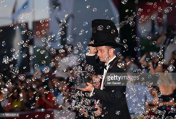 Soapbubble magician Michele Cafaggi a guest of JaegerLeCoultre creates soap bubbles on the red carpet for the 'Emergency' charity at the 'Tracks'...