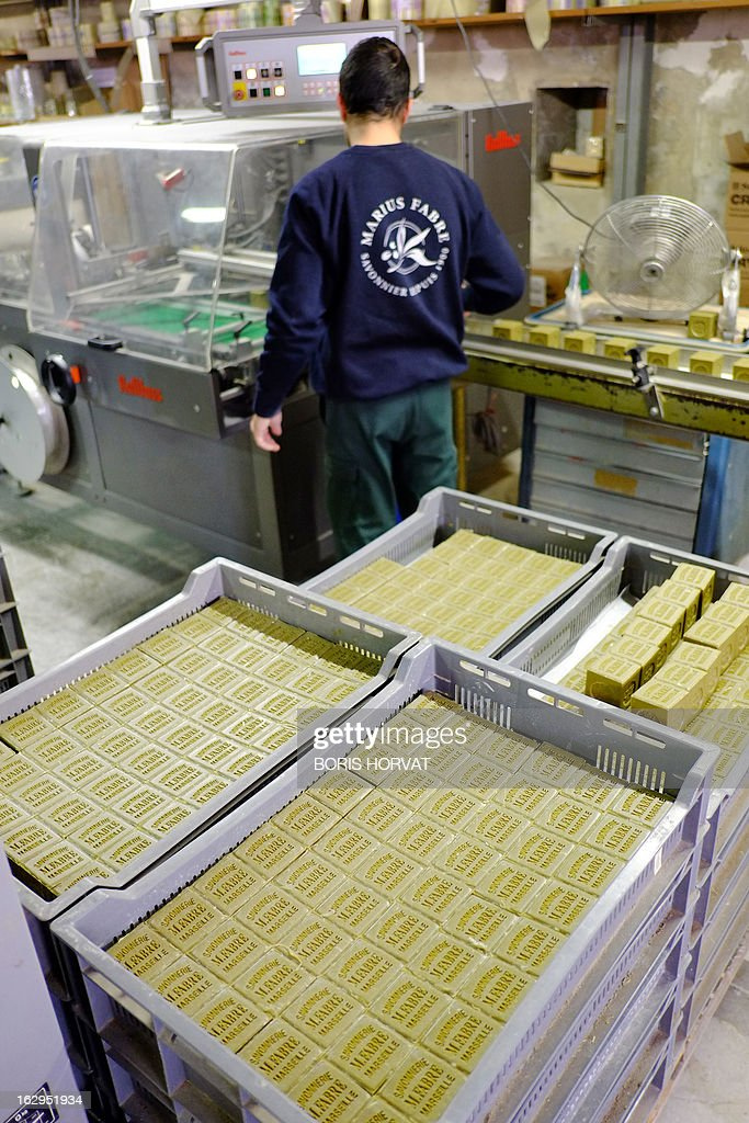 A soap-maker prepares batches of Marseille Soap (Savon de Marseille) on February 26, 2013 in Salon-de-Provence, southern France. The four remaining Marseille soap-makers, who estimate that their product is too often victim to unfair competition by inathentenic products, are cleaning up the market to defend their product, firstly with a collective brand, and soon, they hope, with a 'geographic indication'. 'There is more fake Marseille soap being sold than real' claims Julie Bousquet-Fabre, the president of the Union of professionals of Marseille soap (UPSM).