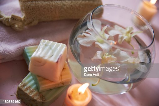 soaps with water bowl of orchids and candle in zen : Stock Photo