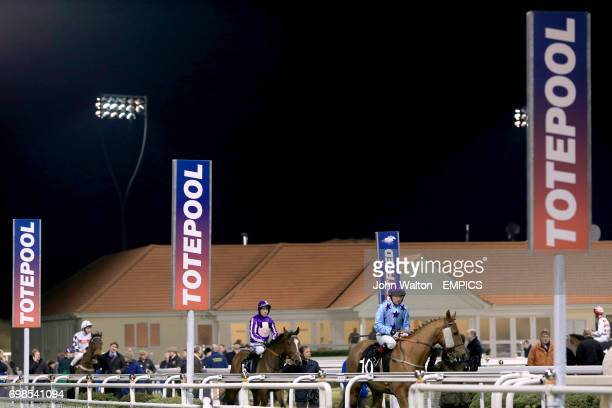 Soaring Spirits ridden by Jimmy Quinn and Lady Brigid ridden by Jim Crowley are paraded before the totequadpot Handicap