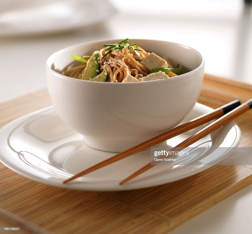Soba noodles and tofu in white bowl : Stock Photo