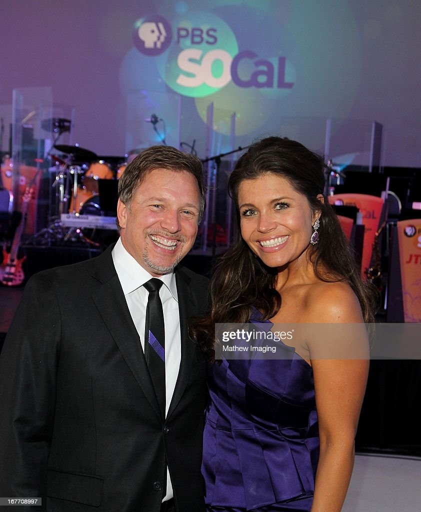 SoCaL Board Member Mindy Stearns (R) and husband Glenn Stearns attend the PBS SoCal 2013 'A Lifetime of Learning' Gala at the Atlantic Aviation Hangar at John Wayne Airport on April 27, 2013 in Santa Ana, California.