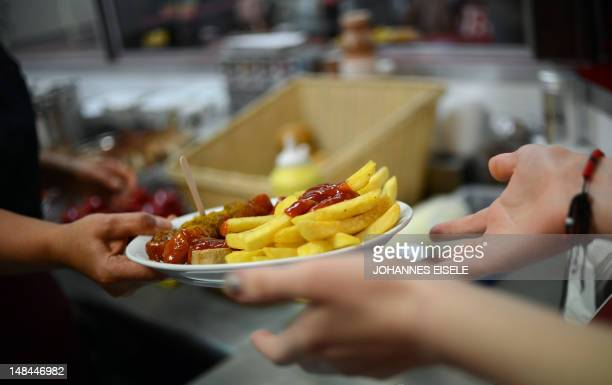 Socalled Currywurst sausages with French fries are served at the Ziervogels Kult Curry restaurant on July 16 2012 in Berlin Currywurst a Berlin...