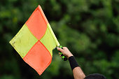 Soccer assistant referee raise flag