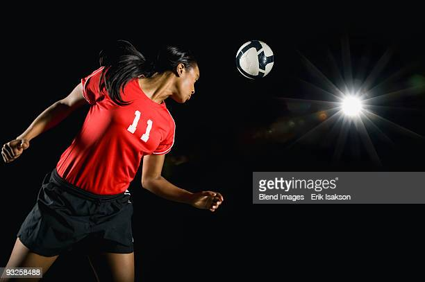 Soccer ball above mixed race soccer player