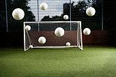 Soccer ball entering soccer net