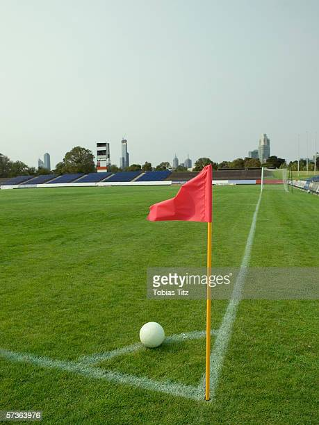 A soccer ball lined up for a corner kick