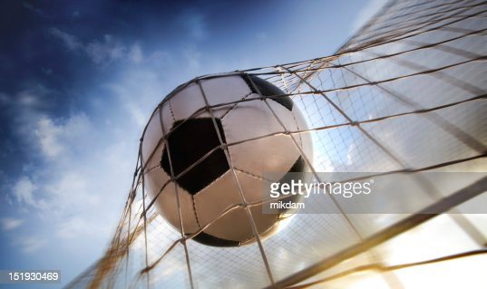 Soccer ball making goal in net : Stock Photo