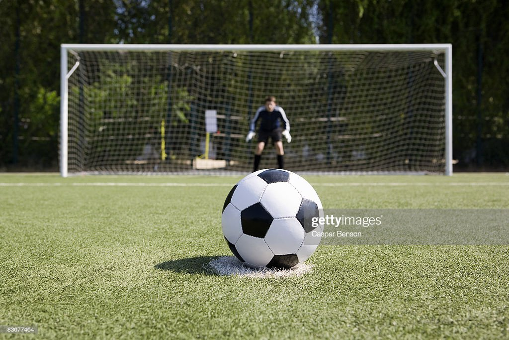 A Soccer Ball On A Soccer Field Stock Photo | Getty Images