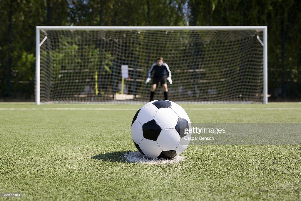 A soccer ball on a soccer field : Stock Photo