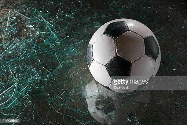 A soccer ball on broken glass