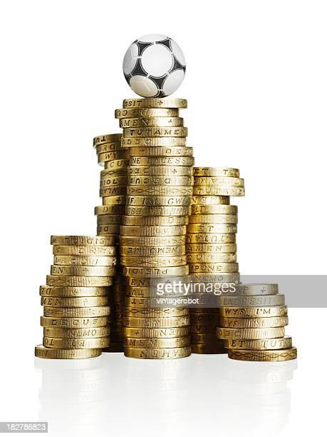 Ballon de football sur pièces d'or
