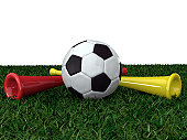 soccer ball on the grass with two vuvuzela