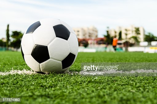 Soccer ball on the green grass of Soccer field. : Stock Photo