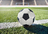 Soccer ball with background goal at stadium