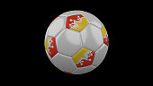 Soccer ball with the flag of Bhutan colors on black background, 3d rendering