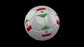 Soccer ball with the flag of Iran colors on black background, 3d rendering