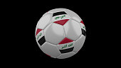 Soccer ball with the flag of Iraq colors on black background, 3d rendering