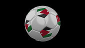 Soccer ball with the flag of Jordan colors on black background, 3d rendering