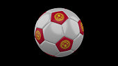 Soccer ball with the flag of Kyrgyzstan colors on black background, 3d rendering
