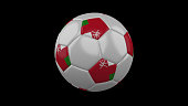 Soccer ball with the flag of Oman colors on black background, 3d rendering