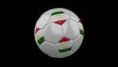 Soccer ball with the flag of Tajikistan colors on black background, 3d rendering