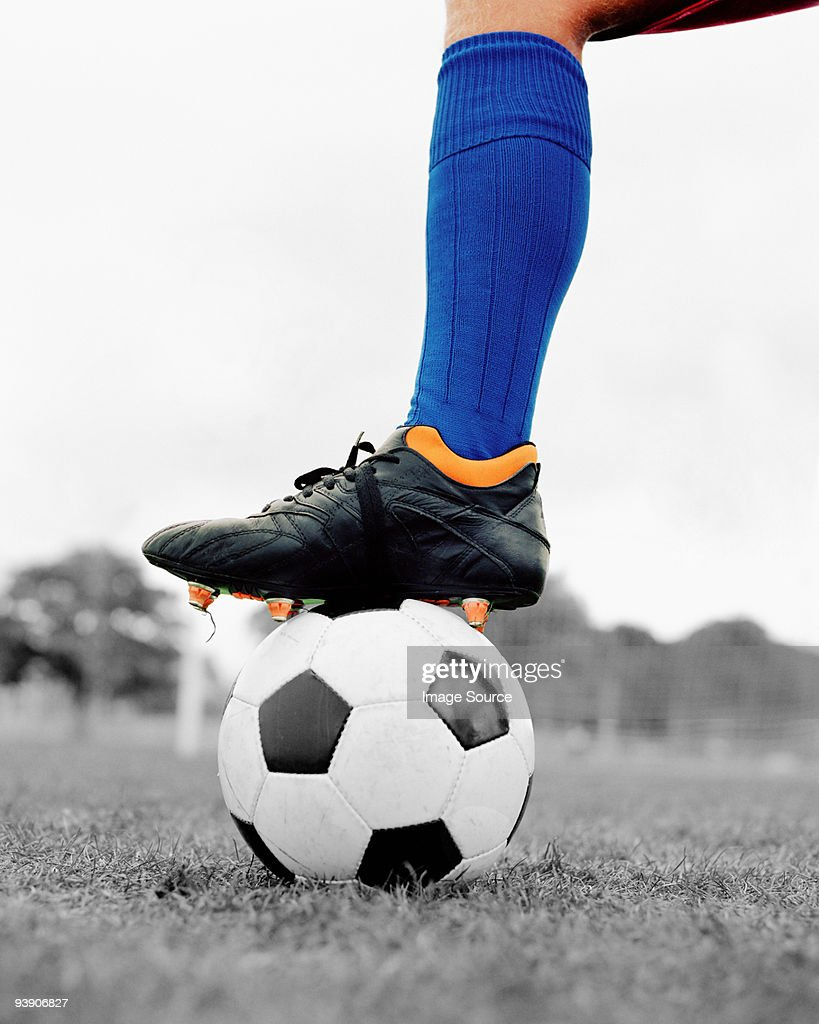 Soccer boot on ball : Stock Photo