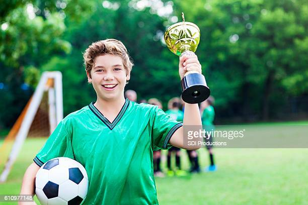 Soccer champ with trophy