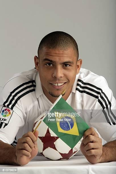 Soccer Closeup portrait of Real Madrid Ronaldo Luis Nazario de Lima with ball equipment and flag of Brazil Los Angeles CA 7/17/2005