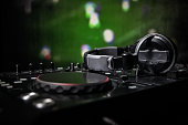 Soccer club party concept. Close up view of dj deck with selective focus. Useful as club poster, empty space.