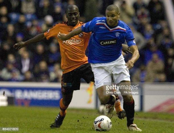 Soccer Clydesdale Bank Scottish Premier League Rangers v Dundee Utd Ibrox Stadium Ranger's Daniel Cousin battles with Dundee United's Morgaro Gomis...