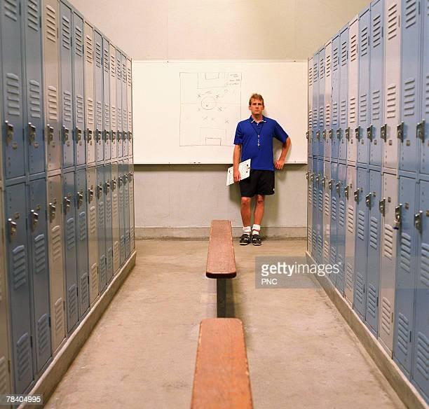Soccer coach in locker room