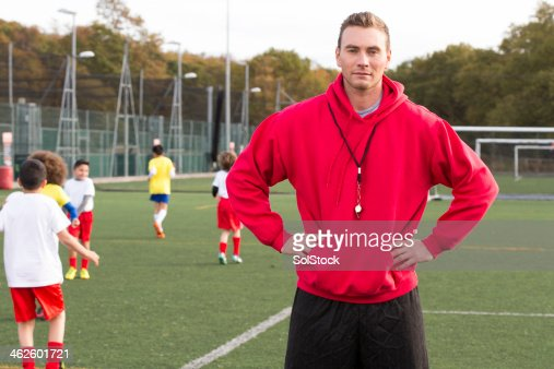 Soccer Coach On The Pitch