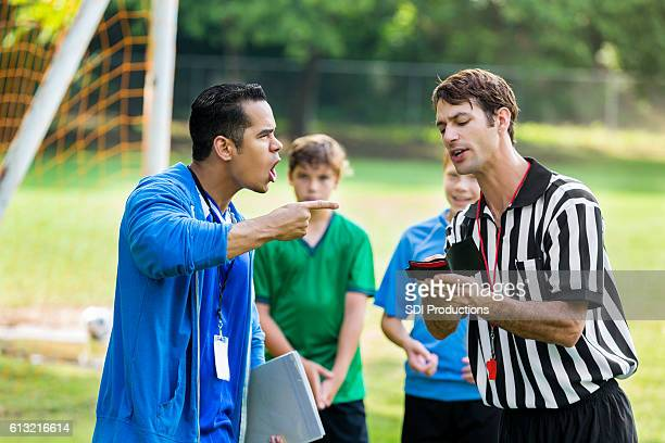 Soccer coach yells at referee over bad call