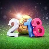 Year date 2018, composed with a gold soccer ball shining on a stadium lawn. 2018 international soccer event. 3D illustration
