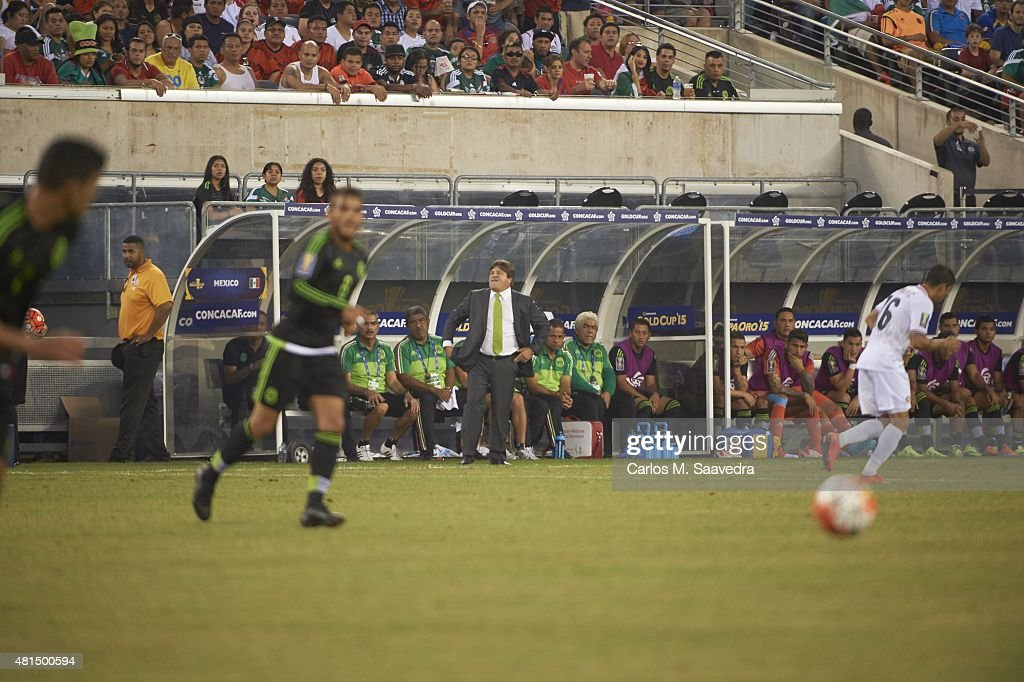 Mexico coach <a gi-track='captionPersonalityLinkClicked' href=/galleries/search?phrase=Miguel+Herrera+-+Soccer+Coach&family=editorial&specificpeople=12319687 ng-click='$event.stopPropagation()'>Miguel Herrera</a> on sidelines during game vs Costa Rica during Quarterfinals at MetLife Stadium. Carlos M. Saavedra TK1 )