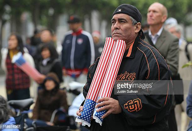 A soccer fan holds American flag thunder sticks as he watches a live telecast of the US women's soccer World Cup semifinal game against France on...