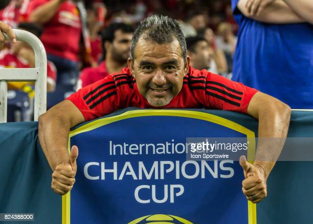 Soccer fan holds event banner during the International Champions Cup match between Manchester United and Manchester City on July 20 2017 at NRG...