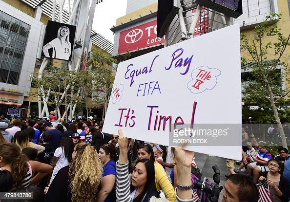 A soccer fan holds up a sign calling for equal pay for female athletes at the US Women's World Cup football team's championship celebration rally at...