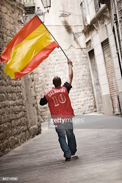 Soccer Fan Waving Flag in Street