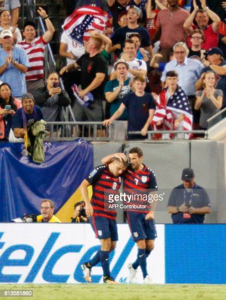US soccer fans cheer as Chris Pontius congratulates forward Jordan Morris after his second and gamewinning goal against Martinique in the second half...