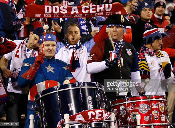 US soccer fans cheer before the start of a 2018 FIFA World Cup qualifying match between the Mexico men's national team and the US men's national team...