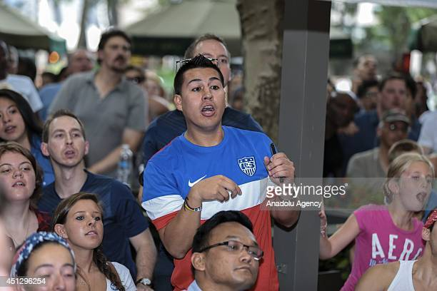Soccer fans gather in Bryant Park to watch the USA v Germany match on the giants screens within the 2014 FIFA World Cup Group G in New YorkJune 262014
