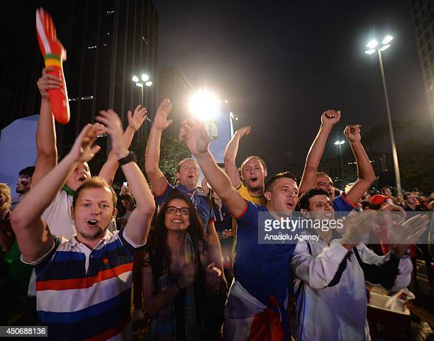 Soccer fans gather to watch the match between France and Honduras within the 2014 FIFA World Cup on a giant screen at the Anhangabau Square in Sao...