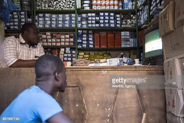 Soccer fans of Burkina Faso watch their national team's match against Gabon on television during 2017 Africa Cup of Nations in Ouagadougo Burkina...